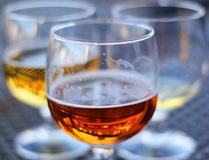three tasting glasses of beer