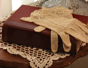 lace gloves and old book