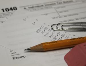 tax forms, pencil, eraser