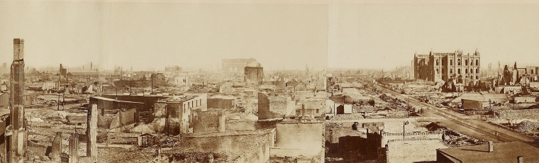 photograph showing panaromic view of burned out buildings and rubble.