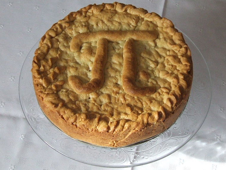 Pie with the letter pi formed on the crust