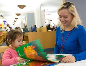 Child reading to volunteer
