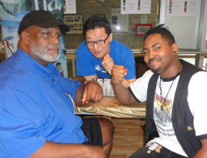 Artists Larry Stroman, Gene Ha, and Elgin Bokari Smith at Pocket Con 2013.