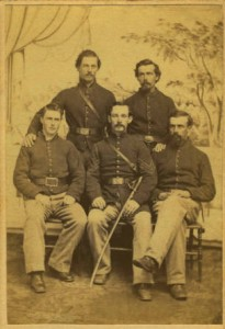 In 1862 many men of Taylors Battery visited a photographers studio in Memphis to have photographs made, such as this carte-de-visite. Seated, left to right: H.T. Chappel, William J. McCoy and William D. Crego. Standing: Nathan J. Young and Sydney Peckham.