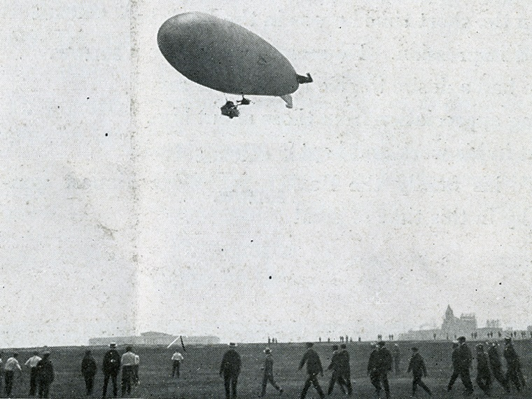 Blimp above people