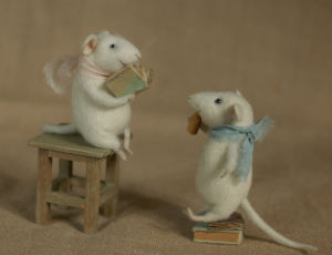 stuffed mice reading