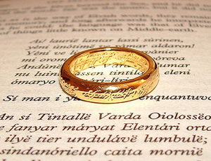gold ring on page from Fellowship of the Ring