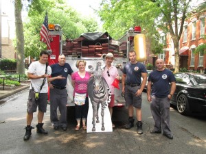 Library employees and CFD firefighters with the library zebra