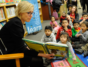 Amy Rule shows a picture book to a group of children
