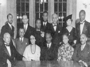 ASNLH 1935 meeting; Woodson is seated on the far left, next to him is CPL librarian, Vivian G. Harsh (Source: George Cleveland Hall Branch Archives, Photo 044, Harsh Research Collection, Chicago Public Library)