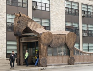 A wooden Trojan horse wraps around the Chicago Red Line station entrance