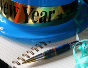 Blue New Year's Eve hat with journal and pen