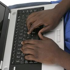 lands typing on laptop