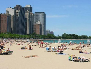 Chicago beach filled with people, high-rises in the background