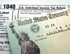 1040 tax form and U.S. Treasure check