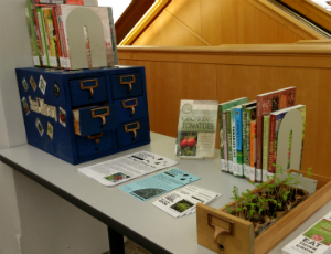 Seed Library in card catalog with books on display