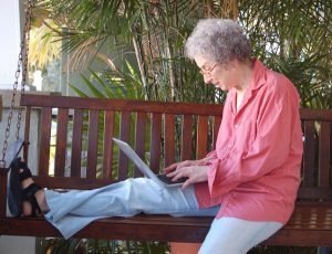 Margaret Atwood with laptop on porch