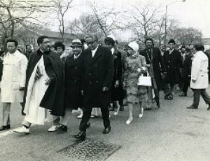 Rev. Clay Evans leads members into the new Fellowship Missionary Baptist Church for Opening Day celebrations, April 8, 1973. Rev. Clay Evans Archive, Photograph 1.262